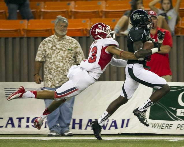 Sep 28, 2013; Honolulu, HI, USA;  Fresno State safety Derron Smith (13) stops Hawaii wide receiver Chris Gant (9) from making a touchdown during the third quarter of the NCAA college football game at Aloha Stadium. Mandatory Credit: Marco Garcia-USA TODAY Sports