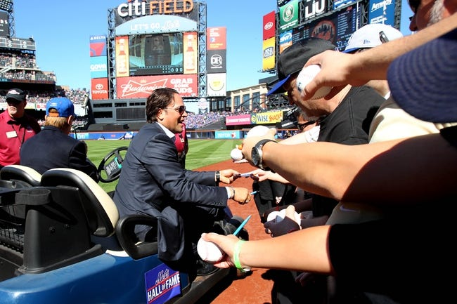 Sep 29, 2013; New York, NY, USA; New York Mets former catcher Mike Piazza signs autographs for fans after his induction into the Mets Hall of Fame prior to the game against the Milwaukee Brewers at Citi Field. Mandatory Credit: Brad Penner-USA TODAY Sports