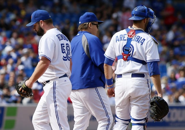 Sep 29, 2013; Toronto, Ontario, CAN; Toronto Blue Jays starting pitcher Todd Redmond (58) leaves the mound after being replaced in the first inning against the Tampa Bay Rays at Rogers Centre. Mandatory Credit: John E. Sokolowski-USA TODAY Sports
