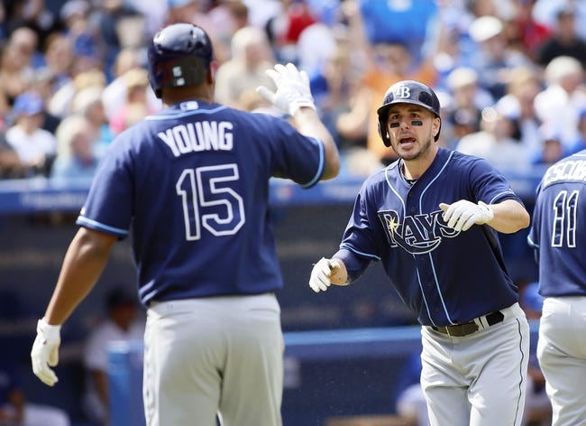 Sep 29, 2013; Toronto, Ontario, CAN; Tampa Bay Rays right fielder Matt Joyce (right) reacts after scoring against the Toronto Blue Jays during the first inning at Rogers Centre. Mandatory Credit: John E. Sokolowski-USA TODAY Sports