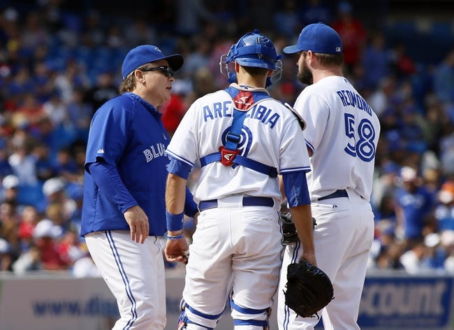 Sep 29, 2013; Toronto, Ontario, CAN; Toronto Blue Jays manager John Gibbons takes out starting pitcher Todd Redmond (58) during the first inning against the Tampa Bay Rays at Rogers Centre. Mandatory Credit: John E. Sokolowski-USA TODAY Sports