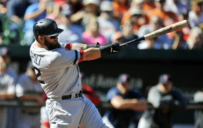 Sep 29, 2013; Baltimore, MD, USA; Boston Red Sox first baseman Mike Napoli (12) doubles in the first inning against the Baltimore Orioles at Oriole Park at Camden Yards. Mandatory Credit: Joy R. Absalon-USA TODAY Sports