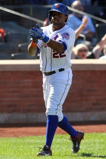 Sep 29, 2013; New York, NY, USA; New York Mets left fielder Eric Young Jr. (22) reacts after scoring a run against the Milwaukee Brewers during the first inning of a game at Citi Field. Mandatory Credit: Brad Penner-USA TODAY Sports
