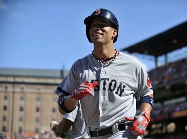 Sep 29, 2013; Baltimore, MD, USA; Boston Red Sox right fielder Quintin Berry (50) smiles as he heads to the dugout after hitting a two-run home run in the second inning against the Baltimore Orioles at Oriole Park at Camden Yards. Mandatory Credit: Joy R. Absalon-USA TODAY Sports