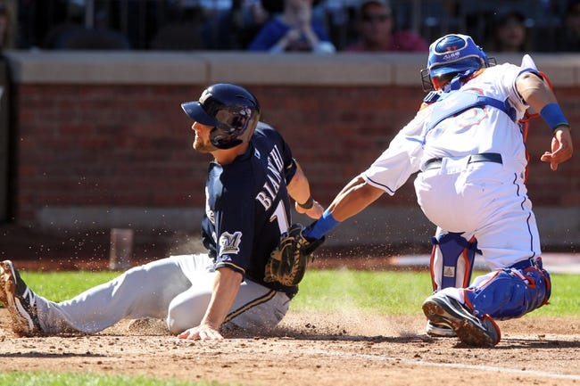 Sep 29, 2013; New York, NY, USA; Milwaukee Brewers third baseman Jeff Bianchi (14) is tagged out at home plate by New York Mets catcher Juan Centeno (36) during the fourth inning of a game at Citi Field. Mandatory Credit: Brad Penner-USA TODAY Sports