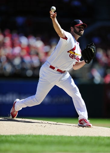 Sep 29, 2013; St. Louis, MO, USA; St. Louis Cardinals starting pitcher Jake Westbrook (35) throws to a Chicago Cubs batter during the first inning at Busch Stadium. Mandatory Credit: Jeff Curry-USA TODAY Sports