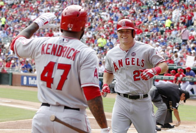 Sep 29, 2013; Arlington, TX, USA; Los Angeles Angels center fielder Mike Trout (27) is congratulated by Los Angeles Angels second baseman Howie Kendrick (47) after he hit a home run in the first inning of the game against the Texas Rangers at Rangers Ballpark in Arlington. Mandatory Credit: Tim Heitman-USA TODAY Sports