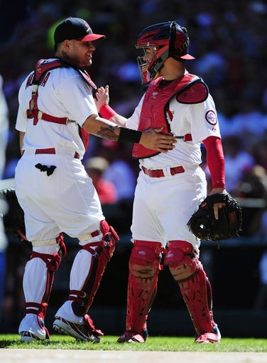Sep 29, 2013; St. Louis, MO, USA; St. Louis Cardinals catcher Yadier Molina (4) is replaced by catcher Tony Cruz (48) during the first inning against the Chicago Cubs at Busch Stadium. Mandatory Credit: Jeff Curry-USA TODAY Sports
