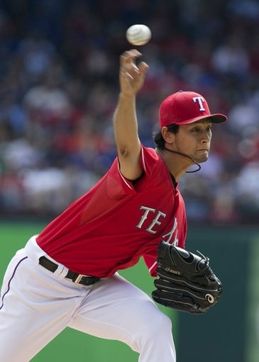 Sep 29, 2013; Arlington, TX, USA; Texas Rangers starting pitcher Yu Darvish (11) throws a pitch in the first inning of the game against the Los Angeles Angels at Rangers Ballpark in Arlington. Mandatory Credit: Tim Heitman-USA TODAY Sports