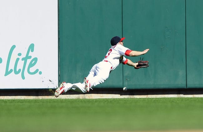 Sep 29, 2013; St. Louis, MO, USA; St. Louis Cardinals left fielder Shane Robinson (43) dives unsuccessfully for a double hit by Chicago Cubs right fielder Nate Schierholtz (not pictured) during the fourth inning at Busch Stadium. Mandatory Credit: Jeff Curry-USA TODAY Sports
