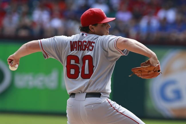 Sep 29, 2013; Arlington, TX, USA; Los Angeles Angels starting pitcher Jason Vargas (60) throws a pitch in the first inning of the game against the Texas Rangers at Rangers Ballpark in Arlington. Mandatory Credit: Tim Heitman-USA TODAY Sports