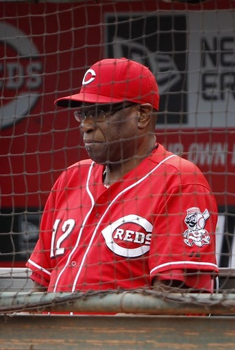 Sep 29, 2013; Cincinnati, OH, USA; Cincinnati Reds manager Dusty Baker (12) in the dugout during the second inning against the Pittsburgh Pirates at Great American Ball Park. Mandatory Credit: Frank Victores-USA TODAY Sports