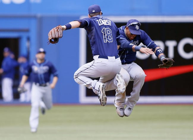 Sep 29, 2013; Toronto, Ontario, CAN; Tampa Bay Rays second baseman Ben Zobrist (18) and shortstop Yunel Escobar (11) celebrate a win over the Toronto Blue Jays at Rogers Centre. Tampa defeated Toronto 7-6. Mandatory Credit: John E. Sokolowski-USA TODAY Sports
