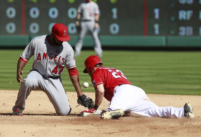Sep 29, 2013; Arlington, TX, USA; Texas Rangers left fielder Craig Gentry (23) steals second base while Los Angeles Angels second baseman Howie Kendrick (47) tries to catch the throw in the fifth inning of the game at Rangers Ballpark in Arlington. Mandatory Credit: Tim Heitman-USA TODAY Sports
