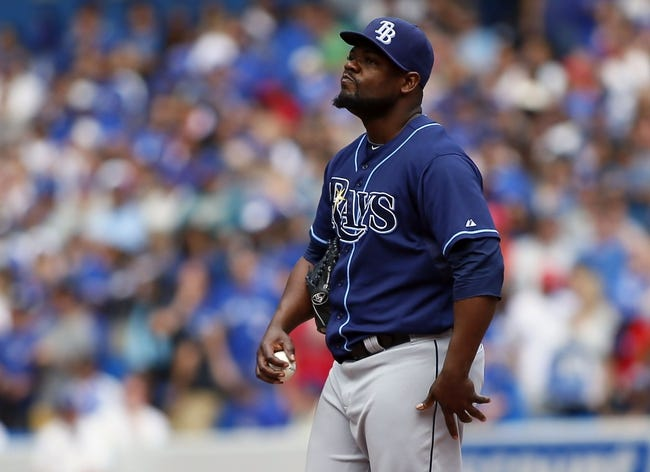 Sep 29, 2013; Toronto, Ontario, CAN; Tampa Bay Rays pitcher Fernando Rodney (56) reacts after walking Toronto Blue Jays third baseman Brett Lawrie (not pictured) in the eighth inning at Rogers Centre. Tampa defeated Toronto 7-6. Mandatory Credit: John E. Sokolowski-USA TODAY Sports