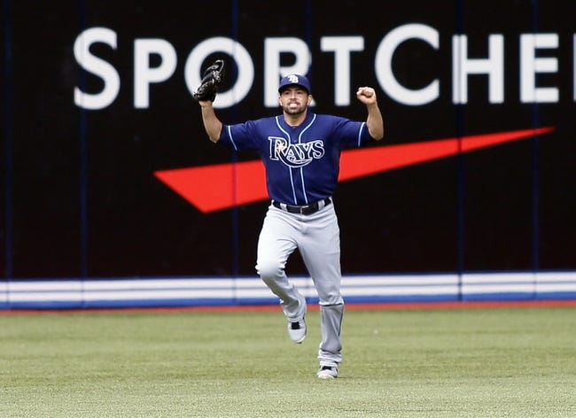 Sep 29, 2013; Toronto, Ontario, CAN; Tampa Bay Rays left fielder David DeJesus (7) reacts after making the last out in the ninth inning against the Toronto Blue Jays at Rogers Centre. Tampa defeated Toronto 7-6. Mandatory Credit: John E. Sokolowski-USA TODAY Sports