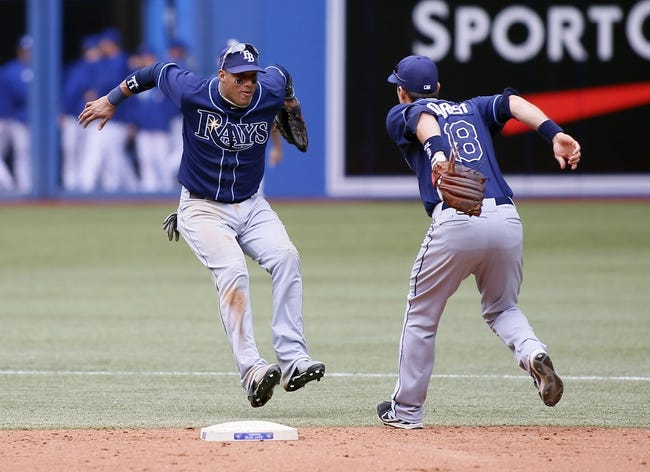 Sep 29, 2013; Toronto, Ontario, CAN; Tampa Bay Rays shortstop Yunel Escobar (11) and second baseman Ben Zobrist (18) celebrate a win over the Toronto Blue Jays at Rogers Centre. Tampa defeated Toronto 7-6. Mandatory Credit: John E. Sokolowski-USA TODAY Sports
