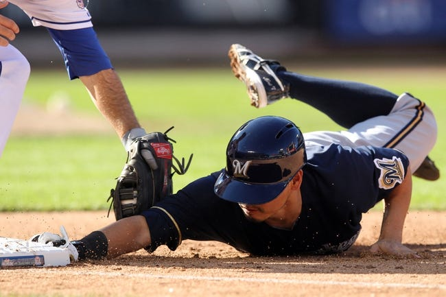 Sep 29, 2013; New York, NY, USA; Milwaukee Brewers right fielder Norichika Aoki (7) dives safely back to first on a pickoff attempt during the eighth inning of a game against the New York Mets at Citi Field. The Mets won 3-2. Mandatory Credit: Brad Penner-USA TODAY Sports
