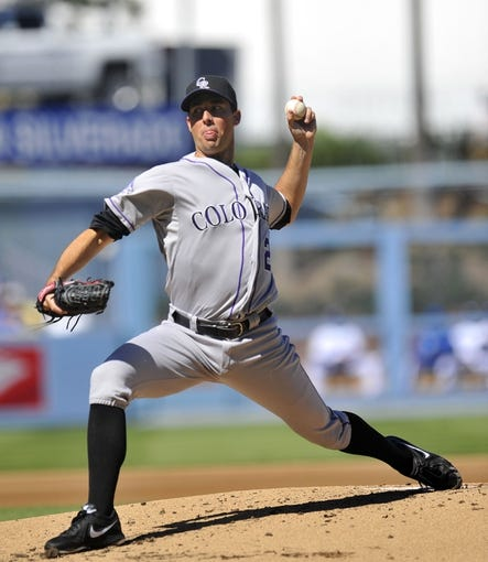 September 29, 2013; Los Angeles, CA, USA; Colorado Rockies starting pitcher Jeff Francis (26) pitches during the first inning against the Los Angeles Dodgers at Dodger Stadium. Mandatory Credit: Gary A. Vasquez-USA TODAY Sports