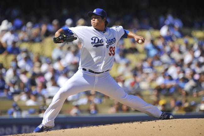 September 29, 2013; Los Angeles, CA, USA; Los Angeles Dodgers  starting pitcher Hyun-Jin Ryu (99) pitches during the second inning against the Colorado Rockies at Dodger Stadium. Mandatory Credit: Gary A. Vasquez-USA TODAY Sports