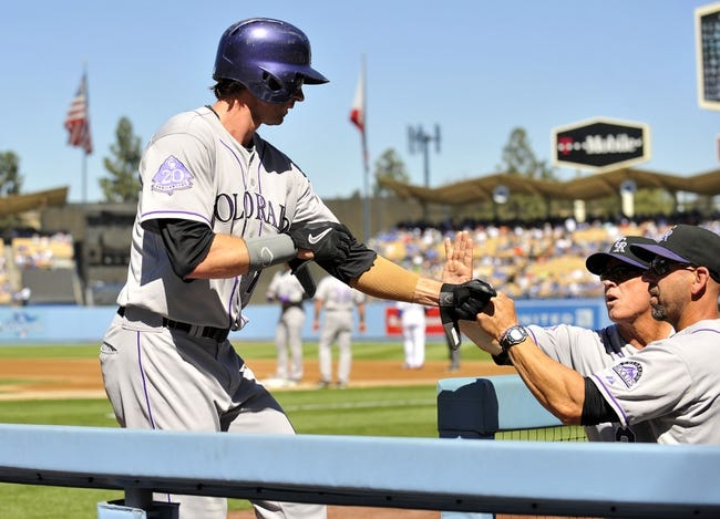 September 29, 2013; Los Angeles, CA, USA; Colorado Rockies right fielder Charlie Blackmon (19) is congratulated after he scores a run in the first inning against the Los Angeles Dodgers at Dodger Stadium. Mandatory Credit: Gary A. Vasquez-USA TODAY Sports