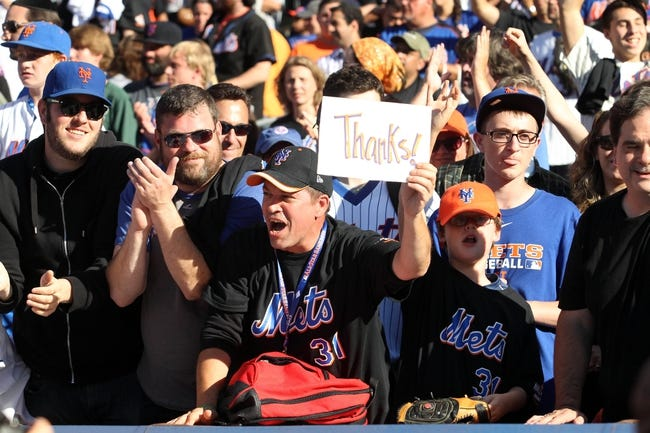 Sep 29, 2013; New York, NY, USA; Fans cheer for the New York Mets after the final game of the season against the Milwaukee Brewers at Citi Field. The Mets won 3-2. Mandatory Credit: Brad Penner-USA TODAY Sports