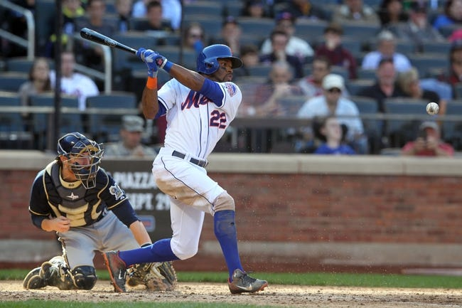 Sep 29, 2013; New York, NY, USA; New York Mets left fielder Eric Young Jr. (22) hits a go-ahead fielder's choice during the eighth inning of a game against the Milwaukee Brewers at Citi Field. The Mets won 3-2. Mandatory Credit: Brad Penner-USA TODAY Sports