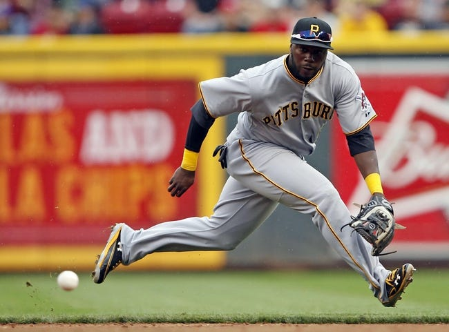 Sep 29, 2013; Cincinnati, OH, USA; Pittsburgh Pirates second baseman Josh Harrison (5) fields a ball during the third inning against the Cincinnati Reds at Great American Ball Park. Mandatory Credit: Frank Victores-USA TODAY Sports