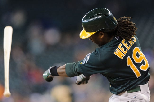 Sep 29, 2013; Seattle, WA, USA; Oakland Athletics second baseman Jemile Weeks (19) loses the bat during the second inning against the Seattle Mariners at Safeco Field. Mandatory Credit: Steven Bisig-USA TODAY Sports