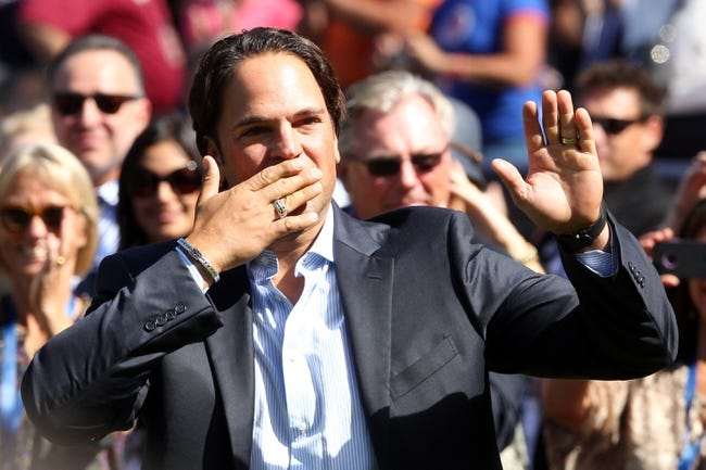 Sep 29, 2013; New York, NY, USA; New York Mets former catcher Mike Piazza blows kisses to the fans during his Mets Hall of Fame ceremony prior to the game against the Milwaukee Brewers at Citi Field. The Mets won 3-2. Mandatory Credit: Brad Penner-USA TODAY Sports