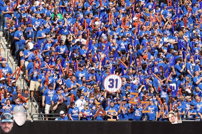 Sep 29, 2013; New York, NY, USA; Mets fans cheer for New York Mets former catcher Mike Piazza prior to his Mets Hall of Fame induction ceremony prior to the game against the Milwaukee Brewers at Citi Field. The Mets won 3-2. Mandatory Credit: Brad Penner-USA TODAY Sports