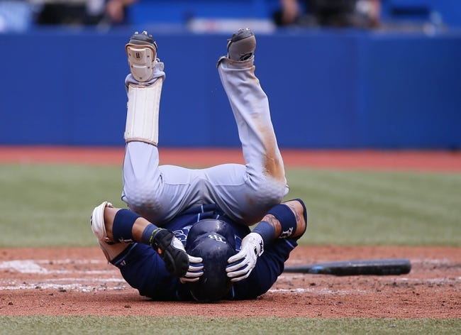 Sep 29, 2013; Toronto, Ontario, CAN; Tampa Bay Rays shortstop Yunel Escobar (11) falls to get out of the way of a Toronto Blue Jays pitch at Rogers Centre. Tampa defeated Toronto 7-6. Mandatory Credit: John E. Sokolowski-USA TODAY Sports