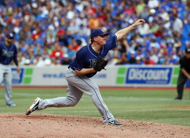Sep 29, 2013; Toronto, Ontario, CAN; Tampa Bay Rays pitcher Jake McGee (57) throws against the Toronto Blue Jays in the seventh inning at Rogers Centre. Tampa defeated Toronto 7-6. Mandatory Credit: John E. Sokolowski-USA TODAY Sports