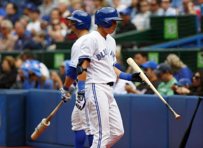 Sep 29, 2013; Toronto, Ontario, CAN; Toronto Blue Jays pinch hitter Munenori Kawasaki (66) goes to the dugout after popping out in the eighth inning against the Tampa Bay Rays at Rogers Centre. Tampa defeated Toronto 7-6. Mandatory Credit: John E. Sokolowski-USA TODAY Sports