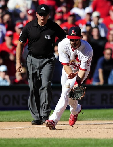 Sep 29, 2013; St. Louis, MO, USA; St. Louis Cardinals third baseman Matt Carpenter (13) fields a ground ball hit by Chicago Cubs center fielder Ryan Sweeney (not pictured) during the ninth inning at Busch Stadium. St. Louis defeated Chicago 4-0 and clinched the best record in the National League. Mandatory Credit: Jeff Curry-USA TODAY Sports