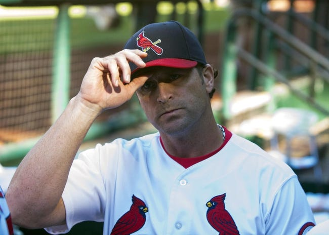 Sep 29, 2013; St. Louis, MO, USA; St. Louis Cardinals manager Mike Matheny (22) salutes the fans after defeating the Chicago Cubs at Busch Stadium. St. Louis defeated Chicago 4-0 and clinched the best record in the National League. Mandatory Credit: Jeff Curry-USA TODAY Sports