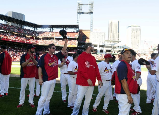Sep 29, 2013; St. Louis, MO, USA; St. Louis Cardinals salute their fans after defeating the Chicago Cubs at Busch Stadium. St. Louis defeated Chicago 4-0 and clinched the best record in the National League. Mandatory Credit: Jeff Curry-USA TODAY Sports
