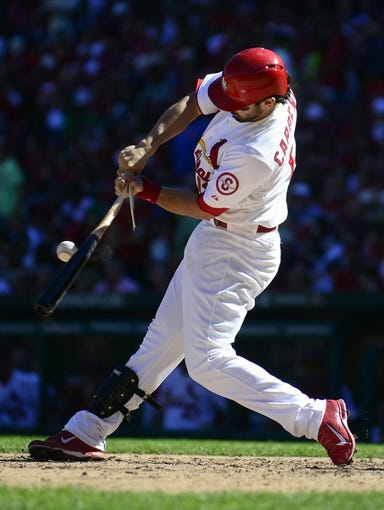Sep 29, 2013; St. Louis, MO, USA; St. Louis Cardinals third baseman Matt Carpenter (13) breaks his bat as he grounds out to Chicago Cubs first baseman Anthony Rizzo (not pictured) during the fifth inning at Busch Stadium. St. Louis defeated Chicago 4-0 and clinched the best record in the National League. Mandatory Credit: Jeff Curry-USA TODAY Sports