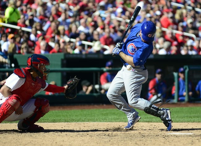 Sep 29, 2013; St. Louis, MO, USA; Chicago Cubs third baseman Donnie Murphy (8) is hit by a pitch from St. Louis Cardinals relief pitcher Joe Kelly (not pictured) during the seventh inning at Busch Stadium. St. Louis defeated Chicago 4-0 and clinched the best record in the National League. Mandatory Credit: Jeff Curry-USA TODAY Sports
