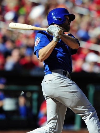 Sep 29, 2013; St. Louis, MO, USA; Chicago Cubs right fielder Nate Schierholtz (19) hits a double off of St. Louis Cardinals relief pitcher Joe Kelly (not pictured) during the seventh inning at Busch Stadium. St. Louis defeated Chicago 4-0 and clinched the best record in the National League. Mandatory Credit: Jeff Curry-USA TODAY Sports
