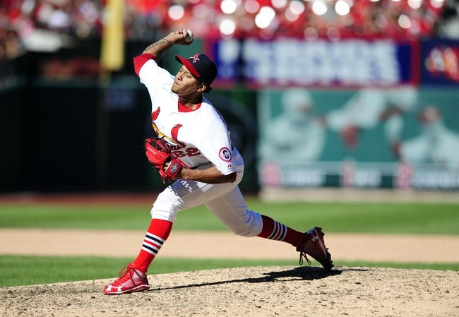 Sep 29, 2013; St. Louis, MO, USA; St. Louis Cardinals relief pitcher Carlos Martinez (62) throws to a Chicago Cubs batter during the eighth inning at Busch Stadium. St. Louis defeated Chicago 4-0 and clinched the best record in the National League. Mandatory Credit: Jeff Curry-USA TODAY Sports
