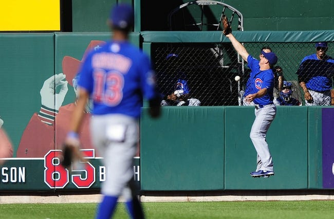 Sep 29, 2013; St. Louis, MO, USA; Chicago Cubs left fielder Brian Bogusevic (47) leaps unsuccessfully for a one run double hit by St. Louis Cardinals catcher Tony Cruz (not pictured) during the eighth inning at Busch Stadium. St. Louis defeated Chicago 4-0 and clinched the best record in the National League. Mandatory Credit: Jeff Curry-USA TODAY Sports