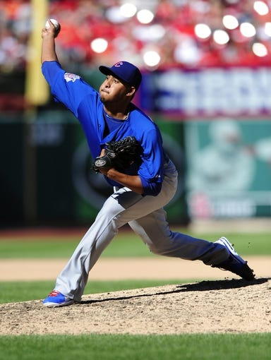 Sep 29, 2013; St. Louis, MO, USA; Chicago Cubs relief pitcher Hector Rondon (56) throws to a St. Louis Cardinals batter during the seventh inning at Busch Stadium. St. Louis defeated Chicago 4-0 and clinched the best record in the National League. Mandatory Credit: Jeff Curry-USA TODAY Sports