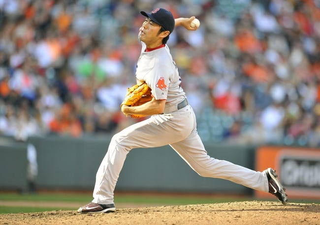 Sep 29, 2013; Baltimore, MD, USA; Boston Red Sox pitcher Koji Uehara (19) throws the ball in the eighth inning against the Baltimore Orioles at Oriole Park at Camden Yards. The Orioles won 7-6. Mandatory Credit: Joy R. Absalon-USA TODAY Sports
