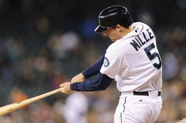 Sep 29, 2013; Seattle, WA, USA; Seattle Mariners shortstop Brad Miller (5) hits a single against the Oakland Athletics during the 4th inning at Safeco Field. Mandatory Credit: Steven Bisig-USA TODAY Sports