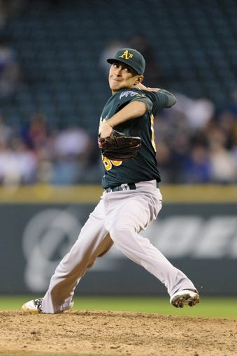 Sep 29, 2013; Seattle, WA, USA; Oakland Athletics relief pitcher Jesse Chavez (60) pitches to the Seattle Mariners during the 6th inning at Safeco Field. Mandatory Credit: Steven Bisig-USA TODAY Sports