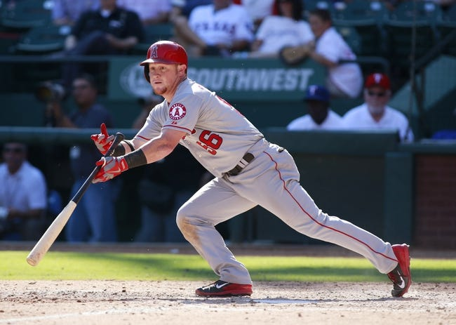 Sep 29, 2013; Arlington, TX, USA; Los Angeles Angels right fielder Kole Calhoun (56) hits a single in the seventh inning of the game against the Texas Rangers at Rangers Ballpark in Arlington. The Rangers beat the Angels 6-2. Mandatory Credit: Tim Heitman-USA TODAY Sports