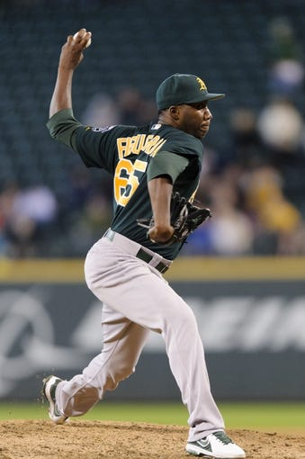 Sep 29, 2013; Seattle, WA, USA; Oakland Athletics relief pitcher Pedro Figueroa (65) pitches to the Seattle Mariners during the 7th inning at Safeco Field. Mandatory Credit: Steven Bisig-USA TODAY Sports