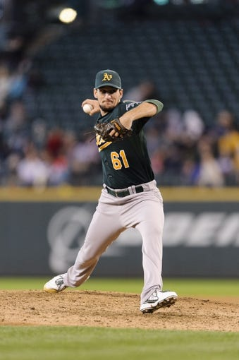 Sep 29, 2013; Seattle, WA, USA; Oakland Athletics relief pitcher Dan Otero (61) pitches to the Seattle Mariners during the 7th inning at Safeco Field. Mandatory Credit: Steven Bisig-USA TODAY Sports