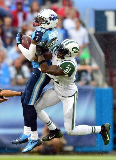 Sep 29, 2013; Nashville, TN, USA; Tennessee Titans wide receiver Nate Washington (85) catches a pass and runs for a touchdown against New York Jets cornerback Antonio Cromartie (31) during the second half at LP Field. The Titans beat the Jets 38-13. Mandatory Credit: Don McPeak-USA TODAY Sports